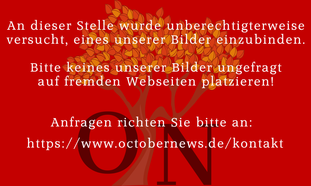 Jens Kriete legt eine Schallplatte in einen Spannrahmen